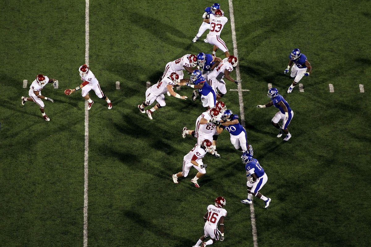 LAWRENCE, KS - OCTOBER 15:  The Oklahoma Sooners run a play against the Kansas Jayhawks during the game on October 15, 2011 at Memorial Stadium in Lawrence, Kansas.  (Photo by Jamie Squire/Getty Images)