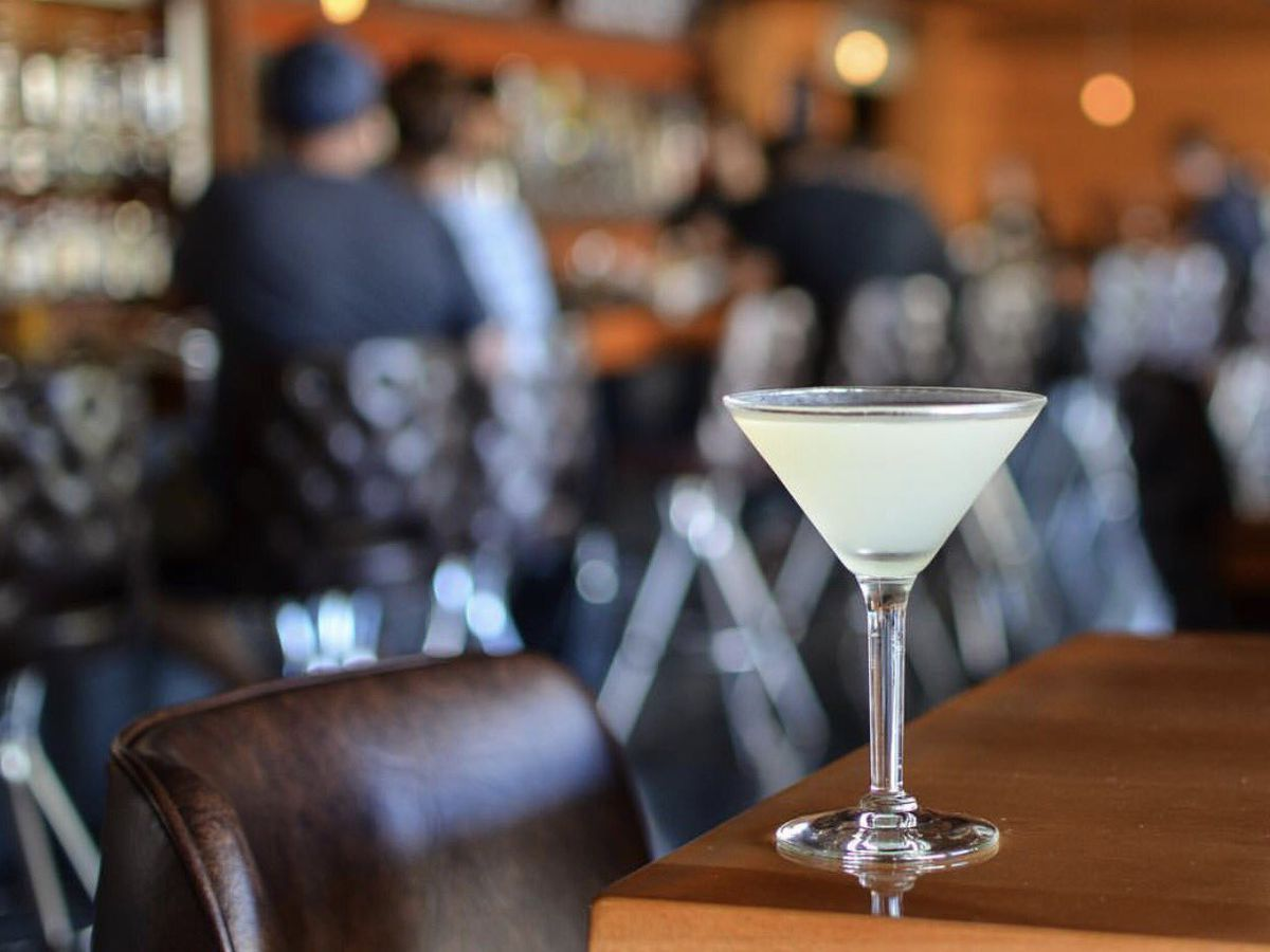 Classic cocktail on wooden bar table