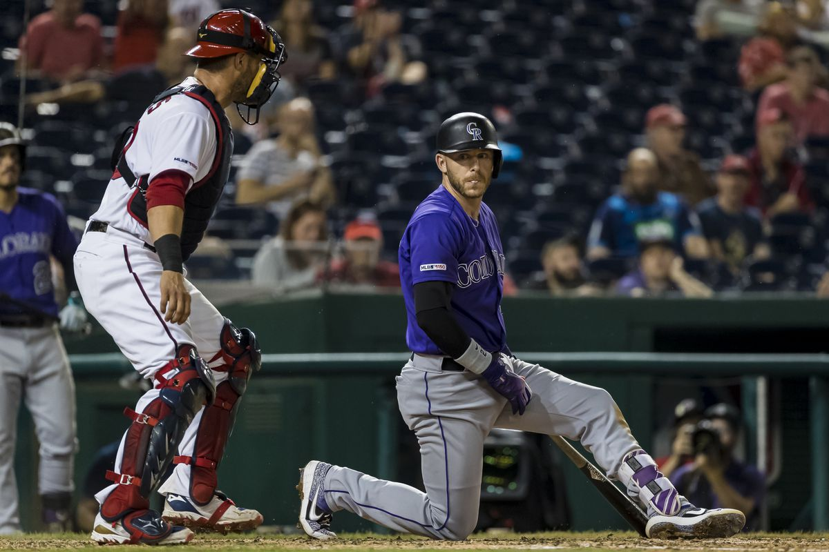 Trevor Story of the Colorado Rockies looks on after striking out against the Washington Nationals during the eighth inning of game two of a doubleheader at Nationals Park on June 24, 2019 in Washington, DC.