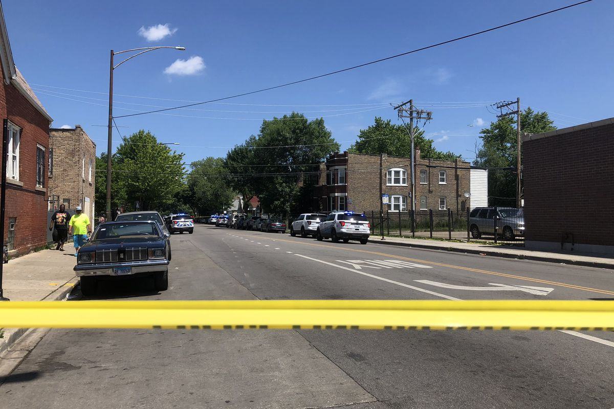 Police investigate after four people were shot July 4, 2019, in the 800 block of North Homan Avenue.