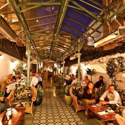 Palm and banana trees line the dining areas at this FiDi alleyway restaurant. With rattan ceiling fans that circulate above patchwork tile floors and vintage photographs of turn-of-the-century Saigon that adorn the walls, Le Colonial evokes the elegant tr