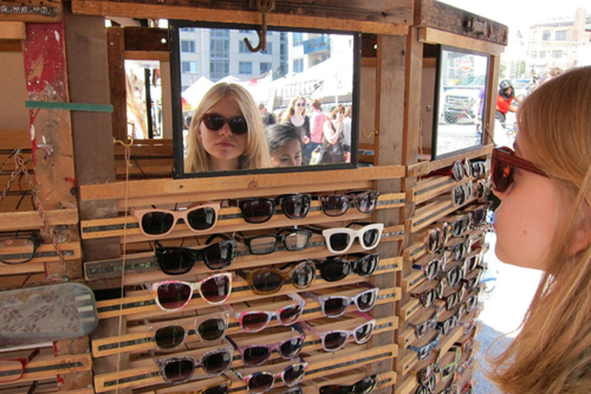 """Trying on sunglasses at the Brooklyn Flea via <a href=""""http://www.flickr.com/photos/scottlynchnyc/7391247250/in/pool-312691@N20/"""">Scoboco</a>/Racked Flickr Pool. Want to contribute? Join <a href=""""http://www.flickr.com/groups/rackedny/pool/with/73912"""