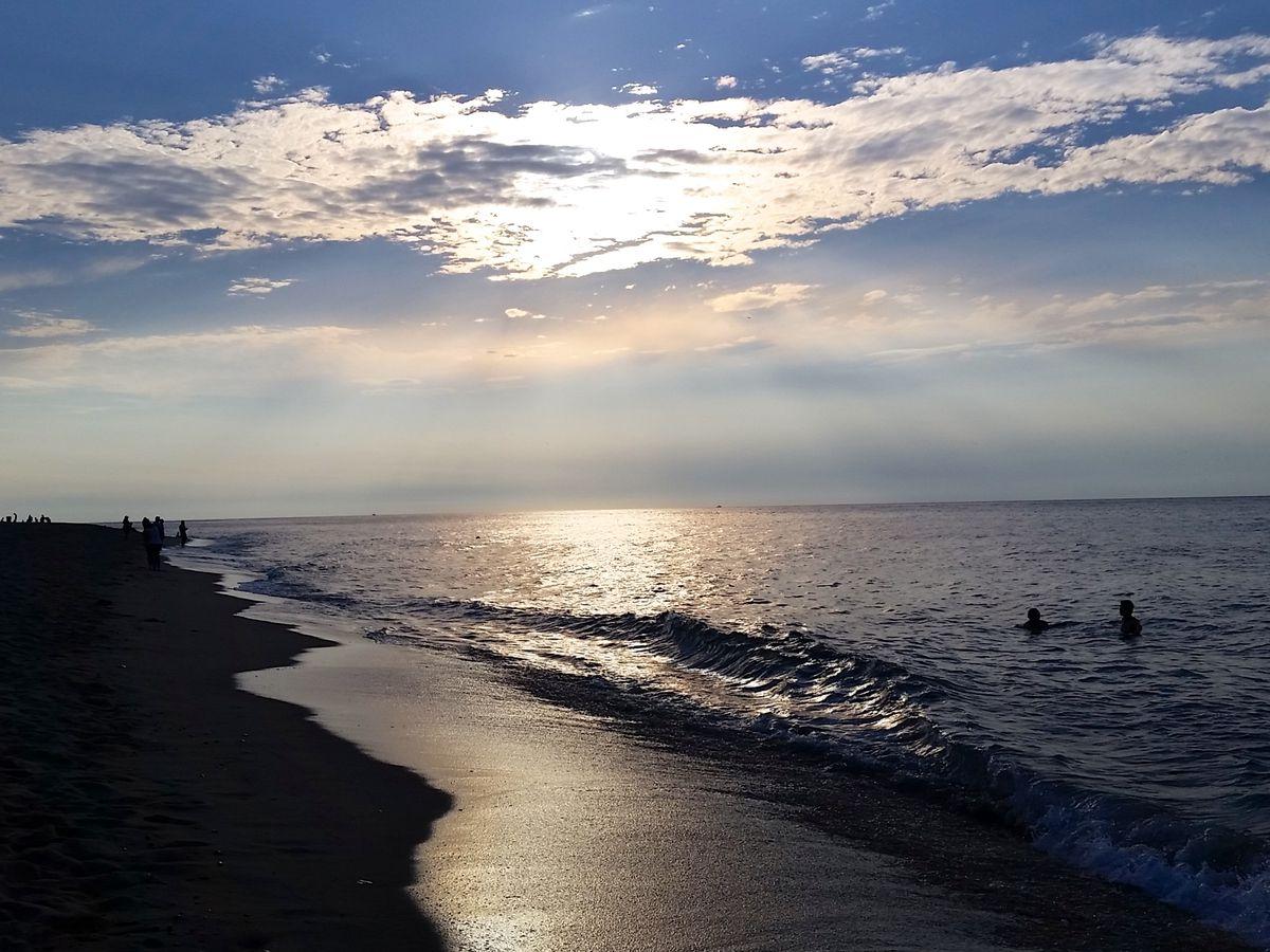 A beach at sunset.