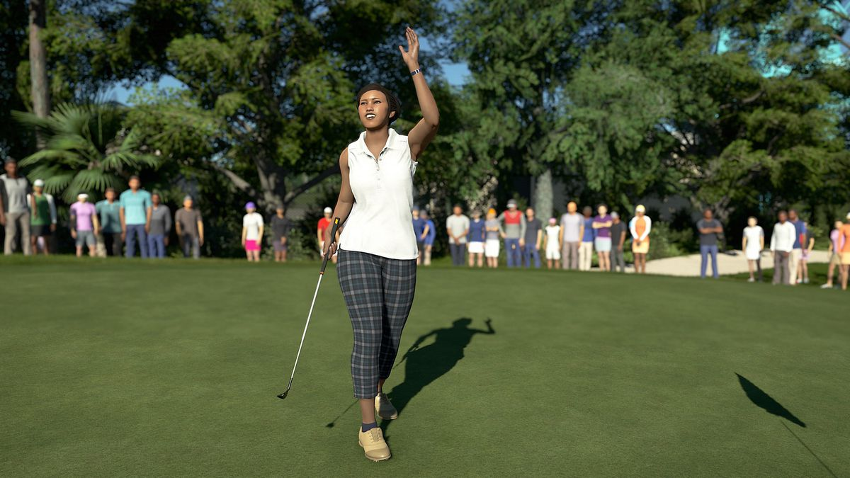 A smiling golfer in a sleeveless blouse waves to the gallery in PGA Tour 2K21