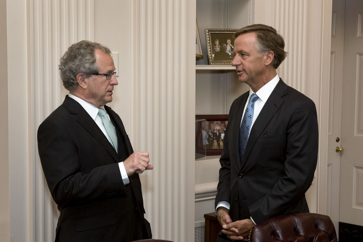 From left: Rep. Mark White of Memphis speaks with Gov. Bill Haslam at a bill-signing ceremony at the State Capitol.