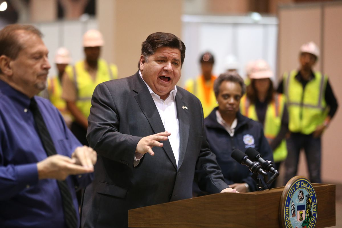 Gov. J.B. Pritzker and Mayor Lori Lightfoot on Friday during the unveiling of the state's massive coronavirus field hospital being set up at McCormick Place East.