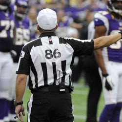 Referee Ken Roan signals a penalty during the second half of an NFL football game between the Minnesota Vikings and the San Francisco 49ers Sunday, Sept. 23, 2012, in Minneapolis.