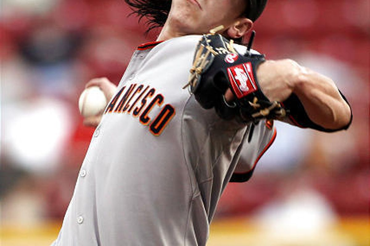 San Francisco Giants pitcher Tim Lincecum throws the ball against the Cincinnati Reds during the first inning Tuesday.