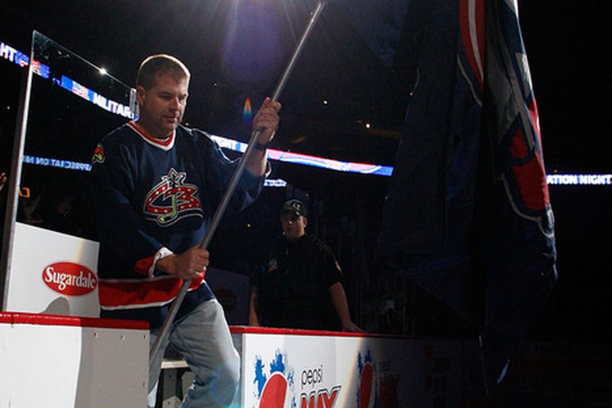 COLUMBUS OH - NOVEMBER 10:  SPC Jay Bolger US Army veteran carries the Columbus Blue Jackets flag as part of the Blue Jackets commemoration of Veteran's Day at Nationwide Arena in Columbus Ohio.  (Photo by John Grieshop/Getty Images)