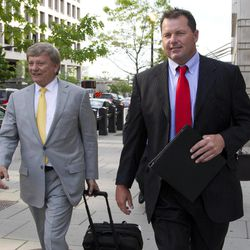 Former Major League Baseball pitcher Roger Clemens and his lawyer Rusty Hardin, left, leave Federal Court in Washington, as the second day of jury selection in his perjury trial wraps uo, Tuesday, April 17, 2012.