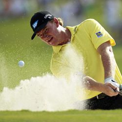 Ernie Els hits out of a bunker onto the 18th green during the first round of a sudden-death playoff against Jason Dufner during the final round of the Zurich Classic golf tournament at TPC Louisiana in Avondale, La., Sunday, April 29, 2012.