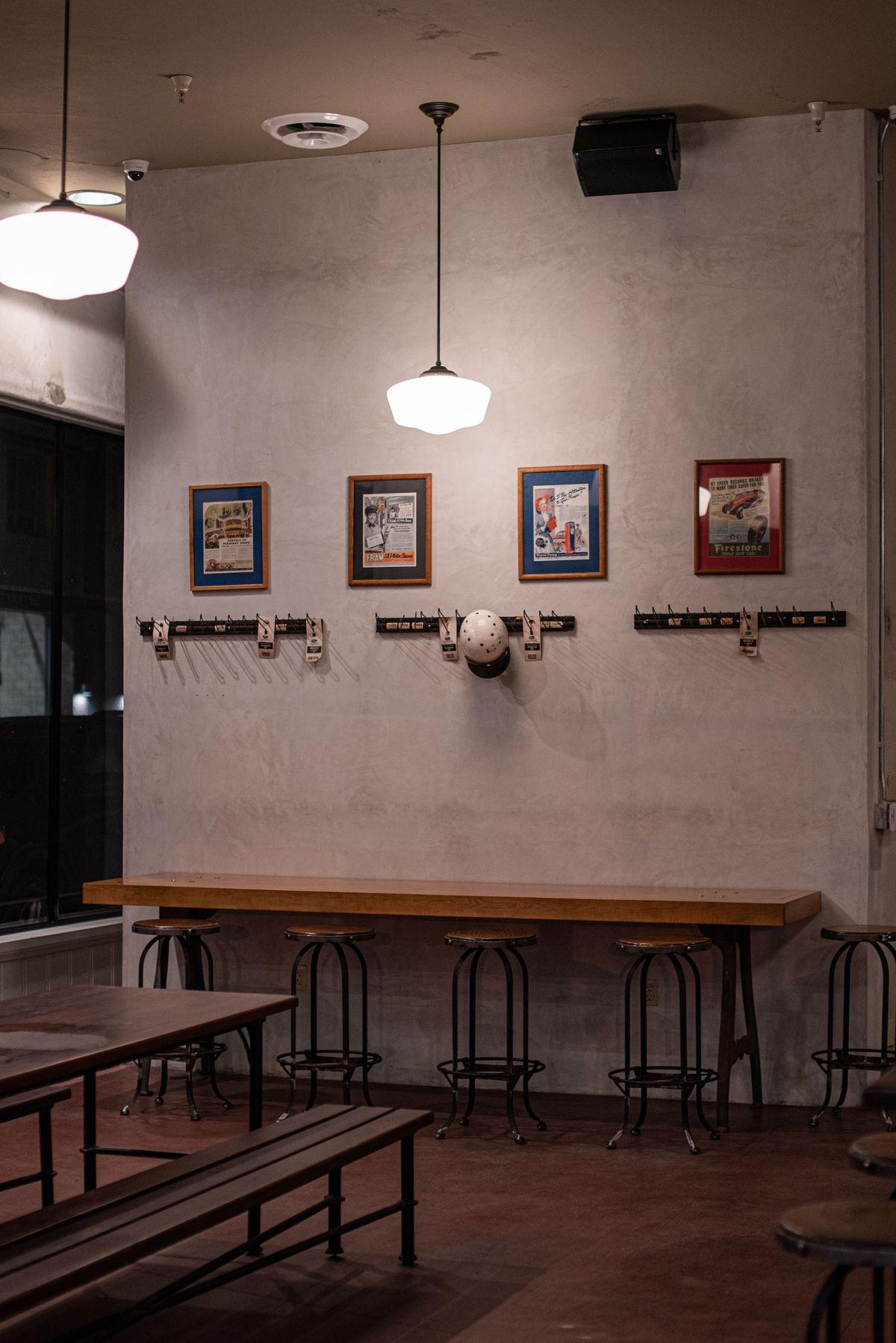 Vintage details hang on racks in low light inside a historic bar.