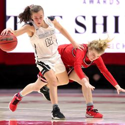 Highland's Carsyn Stephenson and Springville's Brooke Pennington collide at half court as the two teams play in the 5A State Basketball Championship in the Huntsman Center at the University of Utah in Salt Lake City on Saturday, Feb. 29, 2020. Highland won 46-34.