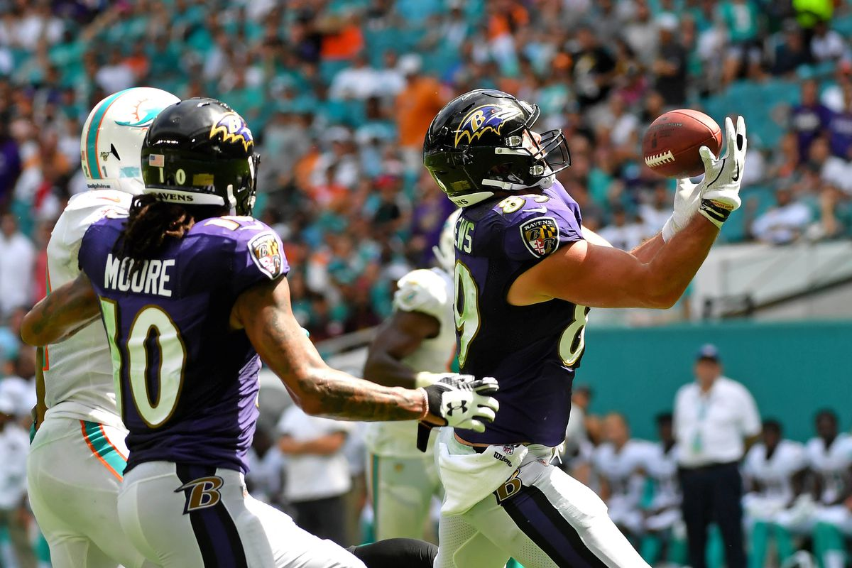 Ravens tight end Mark Andrews hauls in a catch against the Dolphins at Hard Rock Stadium.