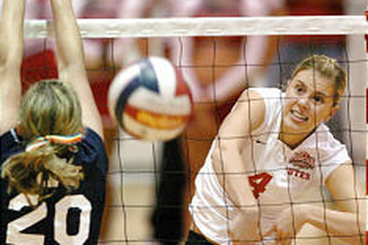 Utah's Shelly Sommerfeldt (4) spikes the ball against BYU defender Jenna Judkins during the Utes' three-game sweep of the Cougars on Saturday.
