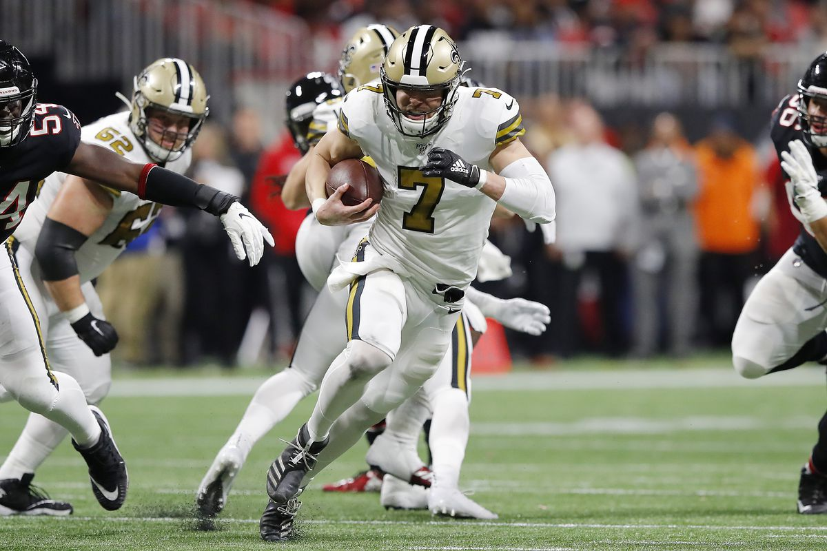 Taysom Hill of the New Orleans Saints runs for a 30-yard touchdown against the Atlanta Falcons during the second quarter at Mercedes-Benz Stadium on November 28, 2019 in Atlanta, Georgia.