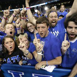 Kentucky fans celebrate after the NCAA Final Four tournament college basketball championship game between Kentucky and Kansas Monday, April 2, 2012, in New Orleans. Kentucky won 67-59.