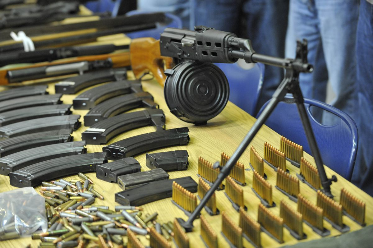 Chicago police have dealt with the proliferation of guns for years. These weapons, drugs and cash were seized in 2010. The firearm in the foreground is an AK-47 with a 75-round magazine. | Sun-Times file photo