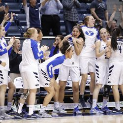 BYU's team celebrates after Cassie Broadhead scores a 3-pointer to tie the first overtime and move it to a second overtime on Thursday, Jan. 26, 2017. The Cougars defeated Santa Clara in double overtime 72-66 at the Marriott Center in Provo.