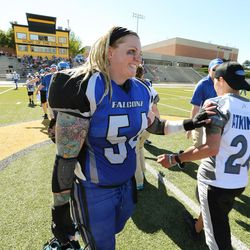 Utah Falconz Kelly Colobella shakes hands with a player from the Colorado Freeze in Murray on June 13, 2015. The Falconz compete in a women's tackle football league.