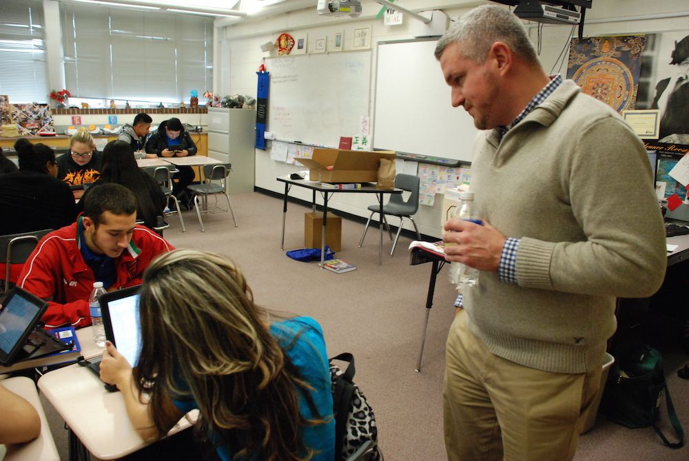 Jefferson High School Principal Michael James, right, visits with students Thursday. James said he hopes politics doesn't get in the way of proposed changes to his school.