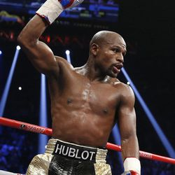 FILE - In this May 2, 2015, file photo, Floyd Mayweather Jr. celebrates during his welterweight title fight against Manny Pacquiao in Las Vegas. Mayweather Jr. said Wednesday, June 14, 2017,  he will come out of retirement to face UFC star Conor McGregor in a boxing match on Aug. 26. Mayweather, who retired in September 2015 after winning all 49 of his pro fights, will face a mixed martial arts fighter who has never been in a scheduled 12-round fight at the MGM Grand arena. The fight will take place in a boxing ring and be governed by boxing rules.