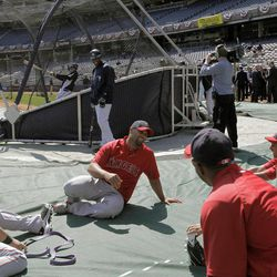 Los Angeles Angels' Albert Pujols, center, is surrounded by teammates during pregame warmupa before the Angels faced the New York Yankees in a baseball game at Yankee Stadium in New York, Friday, April 13, 2012.