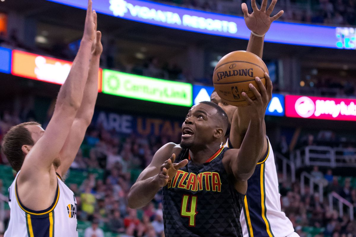 Paul Millsap (4) going in for a layup against the Utah Jazz