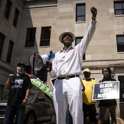 Community activist Eric Russell rallys with protesters in downtown Kenosha in the wake of unrest overnight after police shot Jacob Blake in the the 2800 block of 40th Street, Monday afternoon, Aug. 24, 2020.