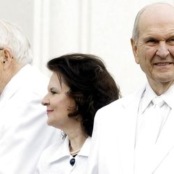 Elder Russell M. Nelson and his wife, Wendy Watson Nelson at right stand with Elder L. Tom Perry after taking their turns at putting mortar around the cornerstone. About 200 take part in the cornerstone ceremony at the Brigham City Temple prior to the dedication Sunday, Sept. 23, 2012.