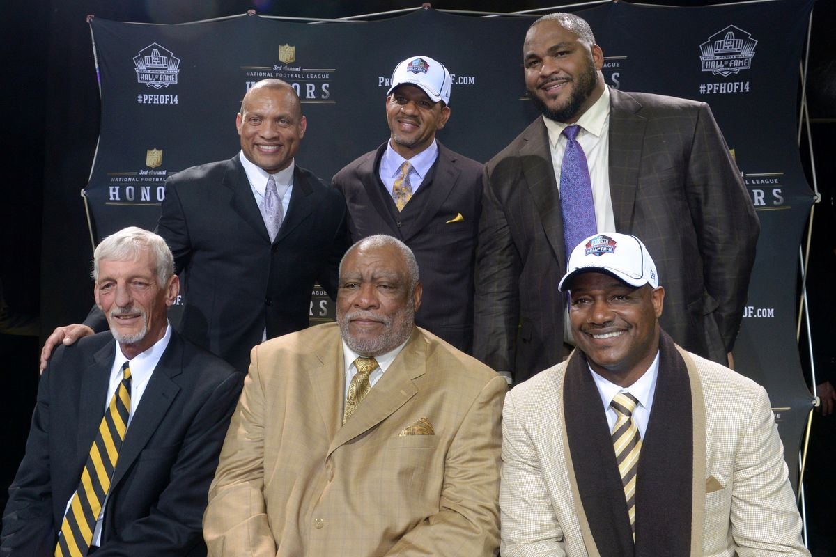 New York, NY, USA; Members of the 2014 Pro Football Hall of Fame class pose at the 3rd NFL Honors at Radio Music City Hall. Front row (from left): Ray Guy, Claude Humphrey & Derrick Brooks. Back row: Aeneas Williams, Andre Reed & Walter Jones.