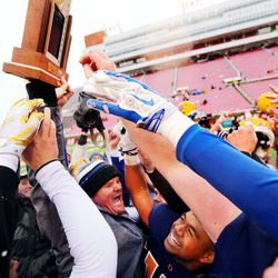 Orem's Head Coach Jeremy Hill lifts the championship trophy as Orem defeats Mountain Crest in the 4A football championship at Rice Eccles Stadium at The University of Utah in Salt Lake City on Friday, Nov. 17, 2017. Orem won 26-0.