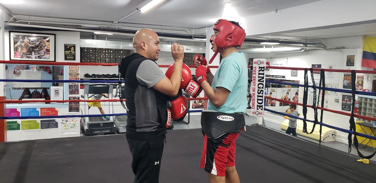 Mario Vega, sports program coordinator at New Life Center in Little Village, coaches Kevin Hernandez, a teen member of the Chicago Youth Boxing Club that Vega helped establish in Little Village, giving youth alternatives to gangs and drugs in Little Villa