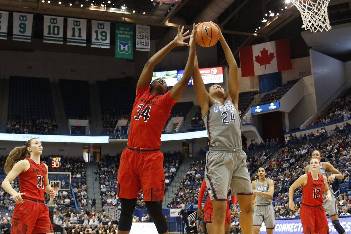 UConn�s Napheesa Collier (24) goes up for a rebound with Maryland's  Brianna Fraser (34).