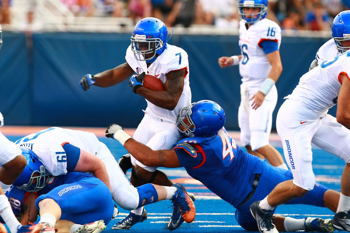 Aug 18, 2012; Boise, ID, USA; Boise State Broncos running back DJ Harper (7) runs for yardage during the fall scrimmage at Bronco Stadium. Mandatory Credit: Brian Losness-US PRESSWIRE