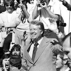 President Carter waves to supporters during a visit to the Beehive State.