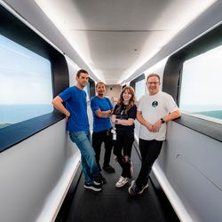 From left to right, Jared Isaacman, Sian Proctor, Hayley Arceneaux, and Christopher Sembroski pose for a photo inside SpaceX's Crew Access Arm, the bridge passengers use to board Crew Dragon on the launchpad.
