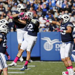 Brigham Young Cougars celebrate a fumble recovery against the San Jose State Spartans during NCAA football in Provo on Saturday, Oct. 28, 2017.