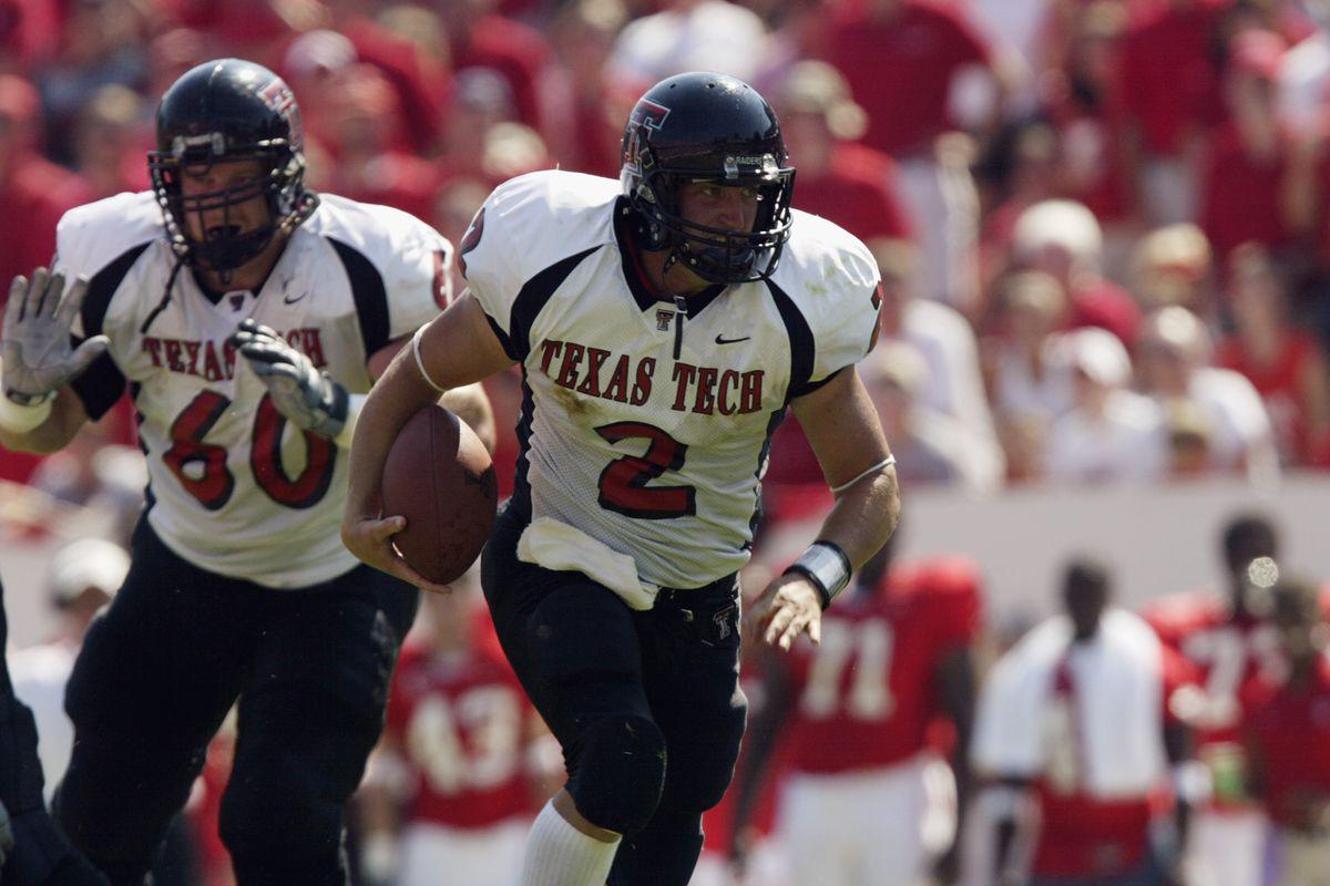 B.J. Symons runs the ball