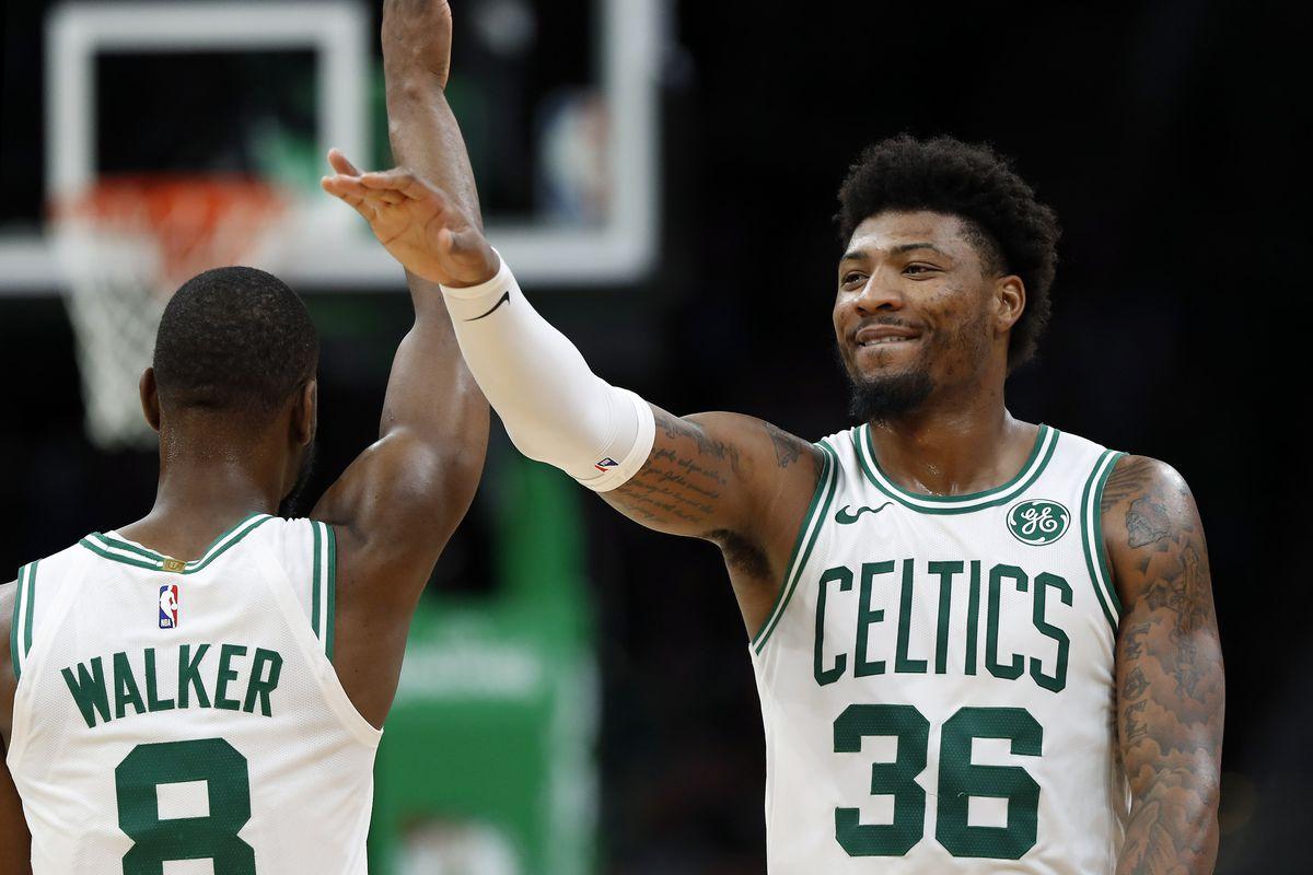 Boston Celtics guard Marcus Smart celebrates with guard Kemba Walker during the fourth quarter against the Dallas Mavericks at TD Garden.