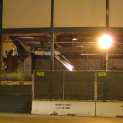 6:00 p.m. Another section of the wall is being brought down, above the ticket windows on the Clark Street side -