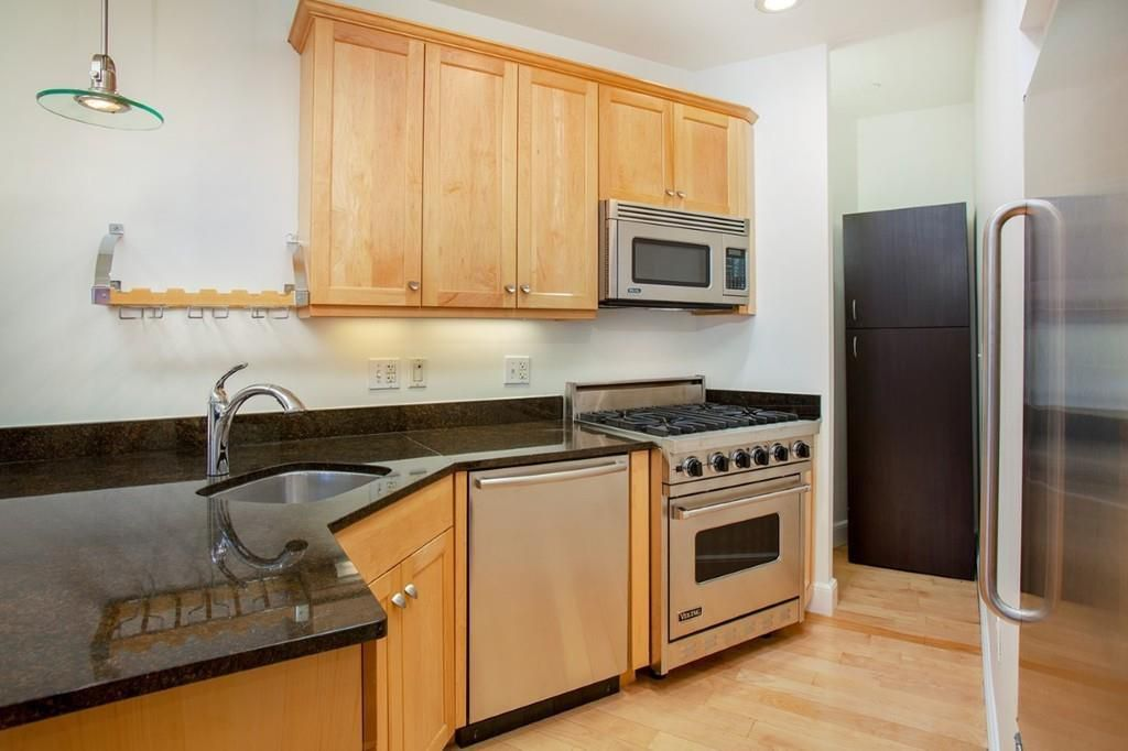 A kitchen with one counter.