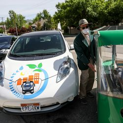 Electric vehicles owners put on a parade to promote better air quality, clean energy