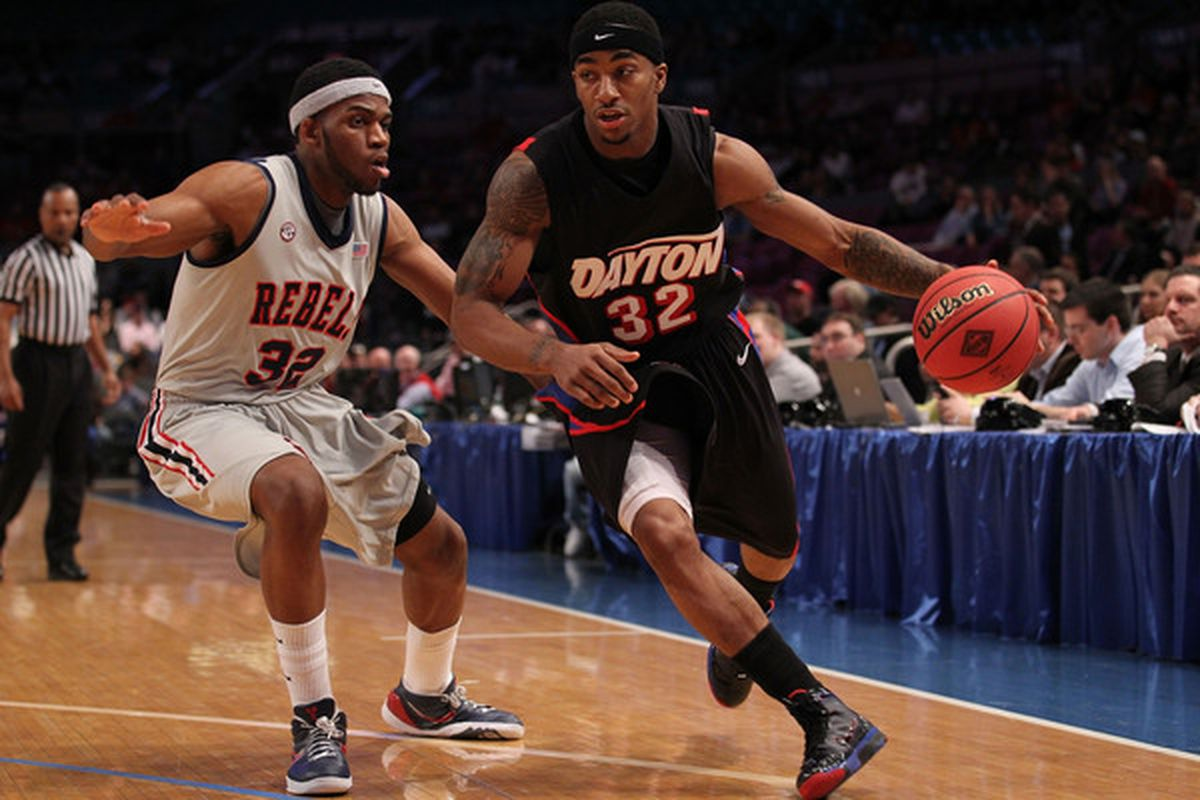 NEW YORK - MARCH 30:  Marcus Johnson #32 of the Dayton Flyers drives against Zach Graham #32 of Ole Miss during their semi final at Madison Square Garden on March 30, 2010 in New York, New York.  (Photo by Nick Laham/Getty Images)
