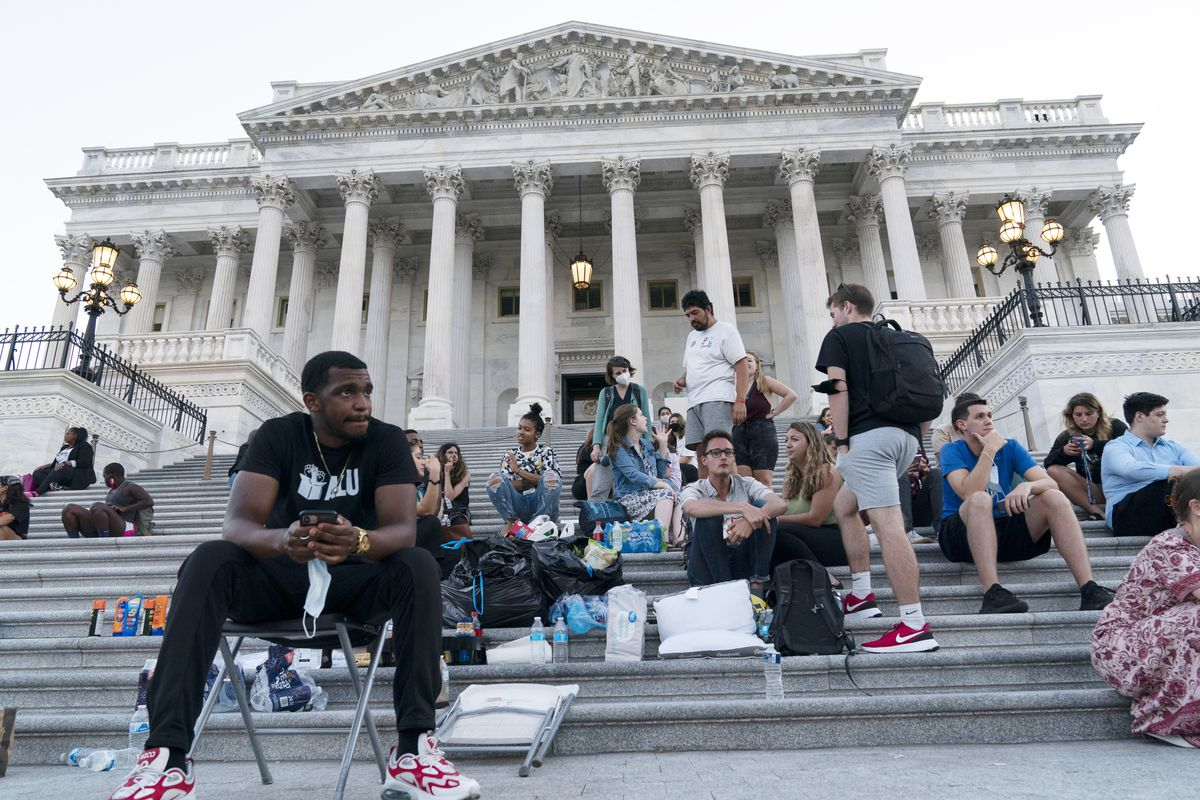 Supporters of Rep. Cori Bush, D-Mo., camp with her outside the U.S. Capitol, in Washington, Monday, Aug. 2, 2021, as anger and frustration has mounted in Congress after a nationwide eviction moratorium expired at midnight Saturday.