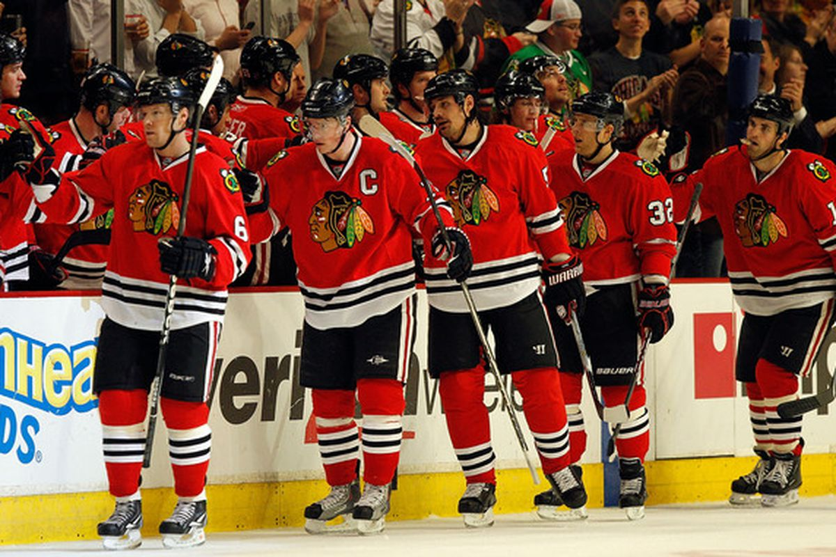 Blackhawks calmly celebrate yet another goal against the Blues. Or douchebag parade. You decide. (Photo by Jonathan Daniel/Getty Images)