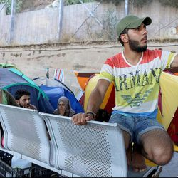 Syrian refugees camp under an overpass near the Port of Piraeus in Athens, Greece, in July 2016.