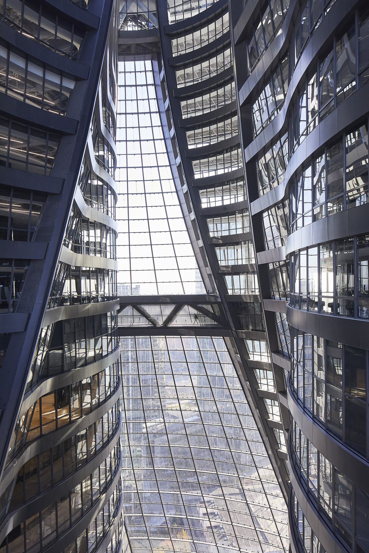 Dramatic, all-glass atrium in a tower.