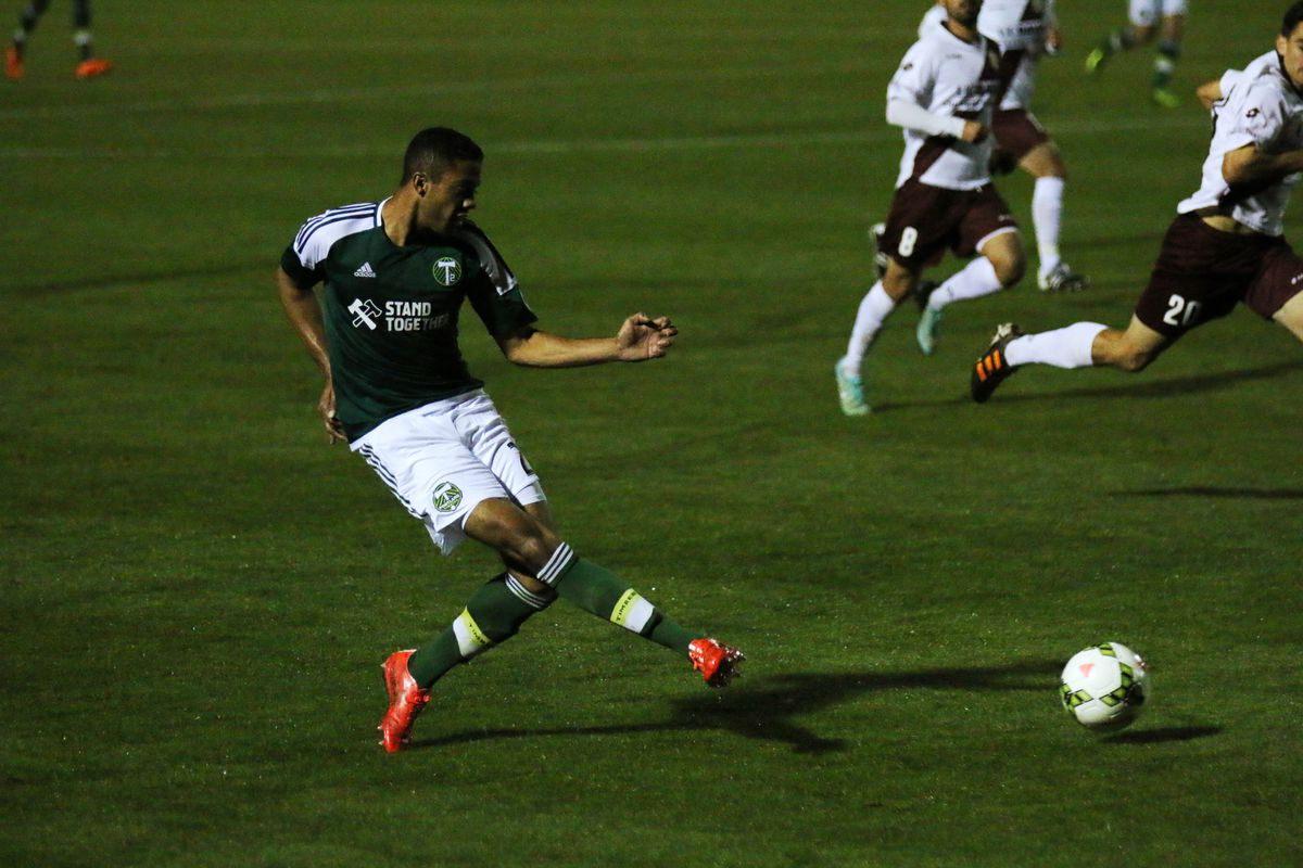 Peay crosses the ball into Belmar for the equalizer against Sacramento on April 2.