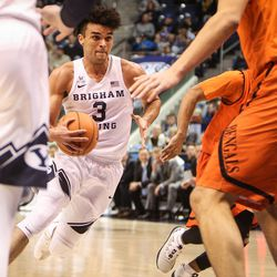 Brigham Young Cougars guard Elijah Bryant (3) drives the lane into the waiting defense of Idaho State Bengals center Novak Topalovic (13) as BYU takes on Idaho State at the Marriott Center in Provo on Thursday, Dec. 21, 2017.